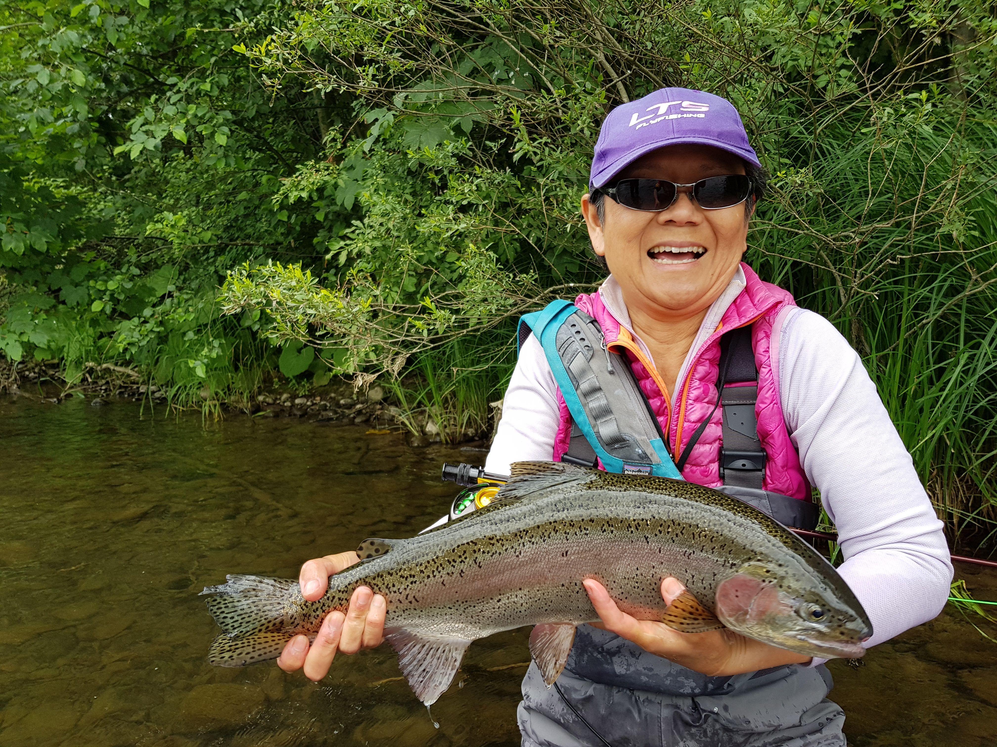 Donna with big Rainbow Trout from Vah River - Slovakia