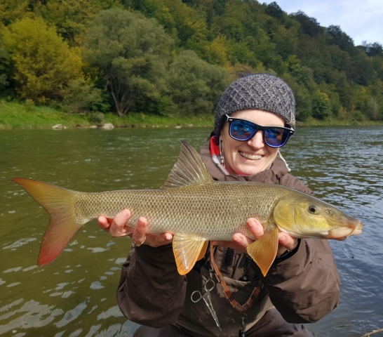 Girls fly fishing in Poland. Wife fishing - barbel