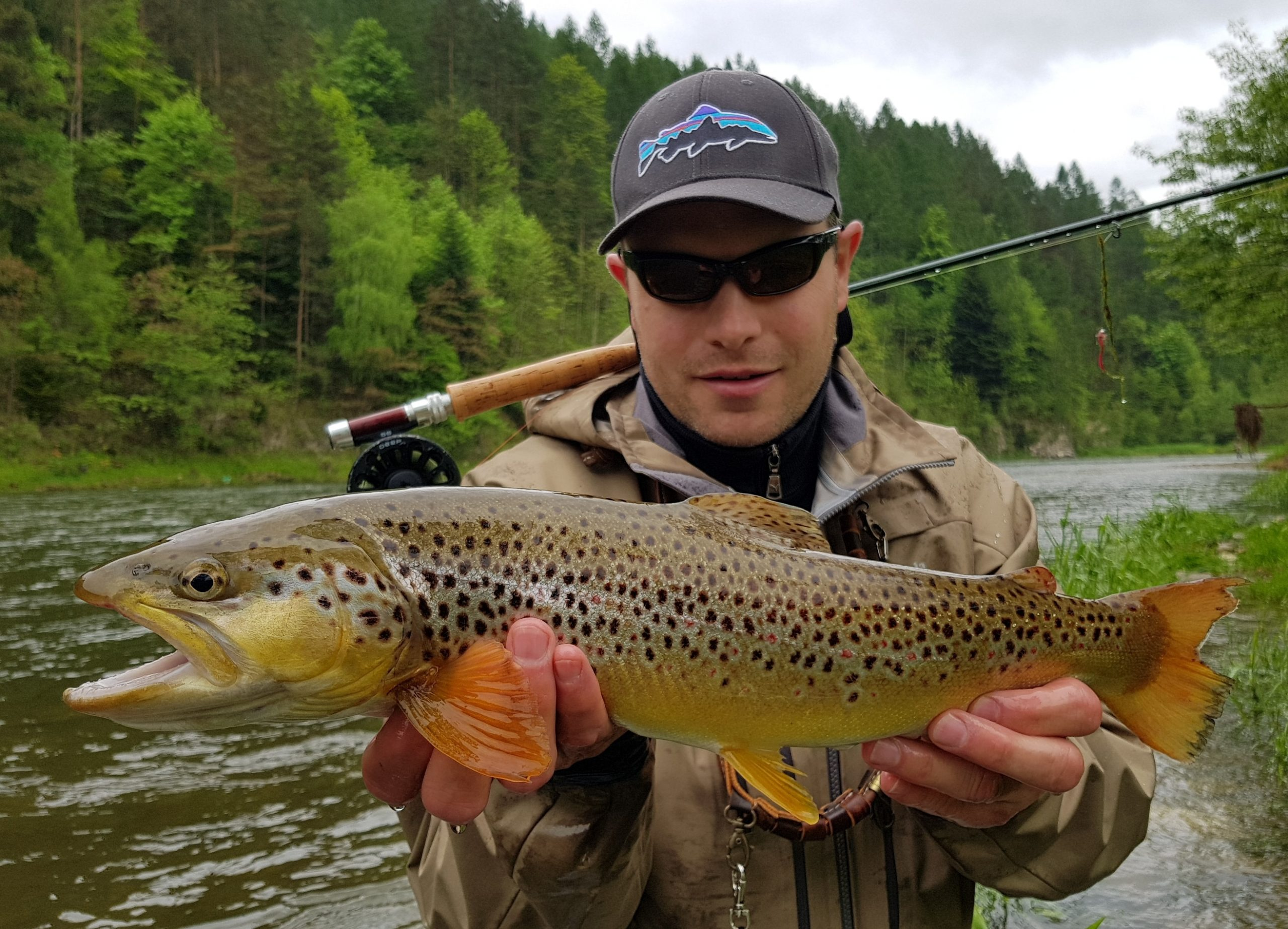 Patagonia hat, squirmy wormie fly and big brown trout