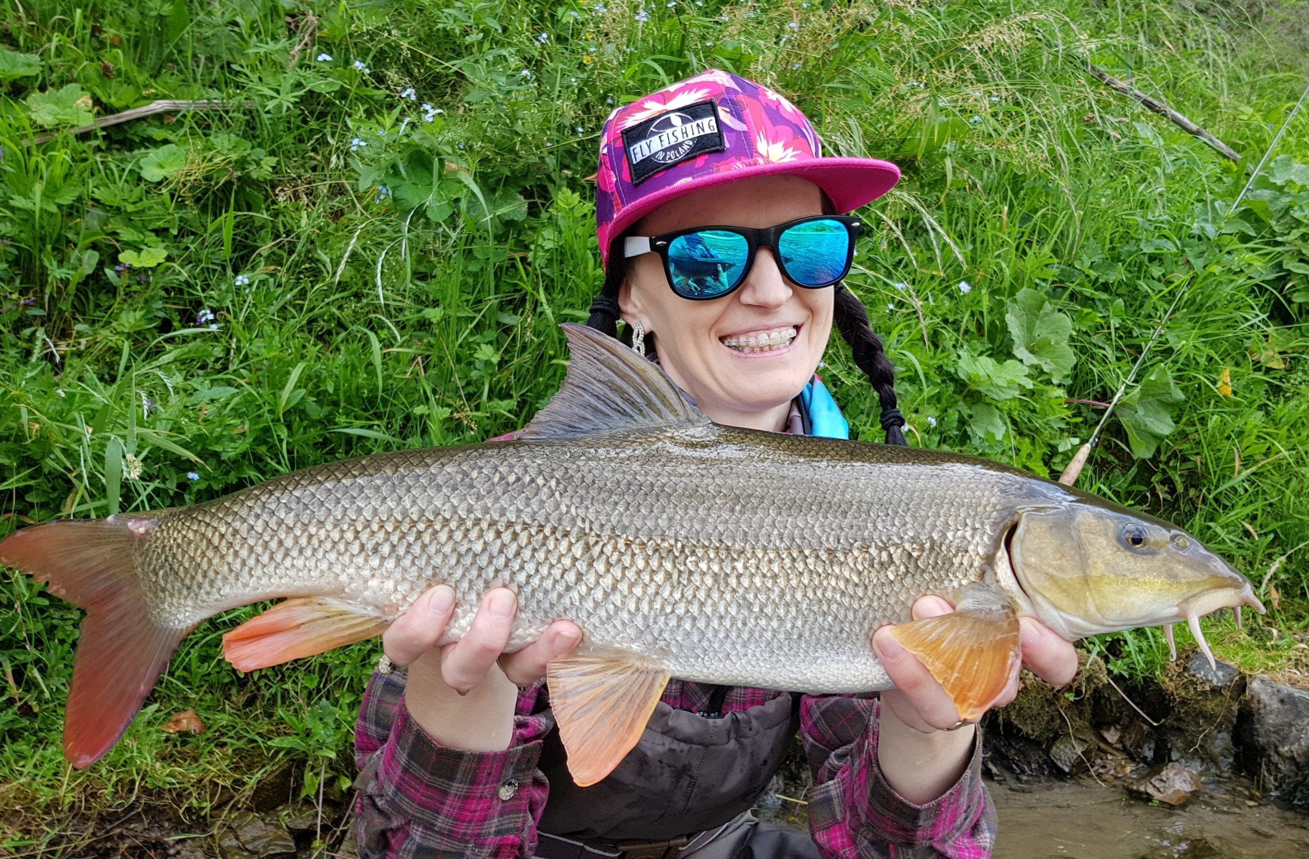 Girl fly fishing - Patagonia shirt brings luck